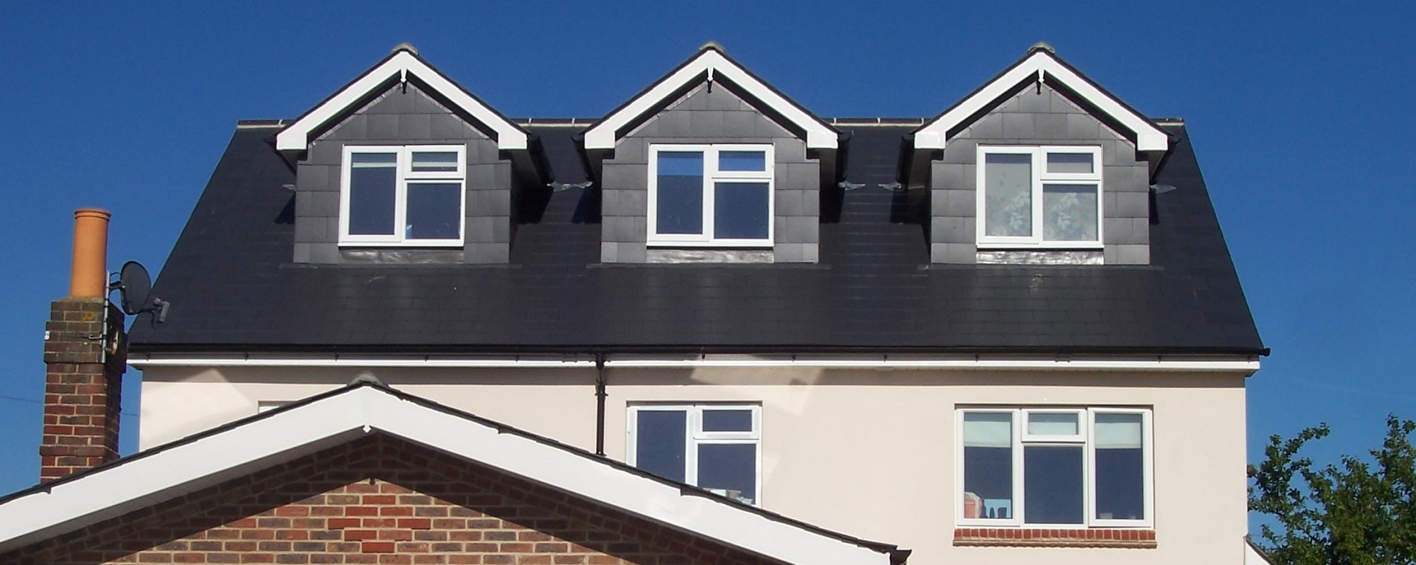 Detached house in Portsmouth loft conversion and side extension with slate dormers to front and rear elevations