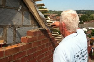 Bricklayer constructing loft conversion gable wall in Drayton, Portsmouth
