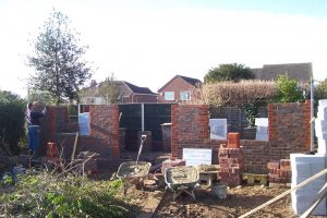 Bricklaying well underway.
