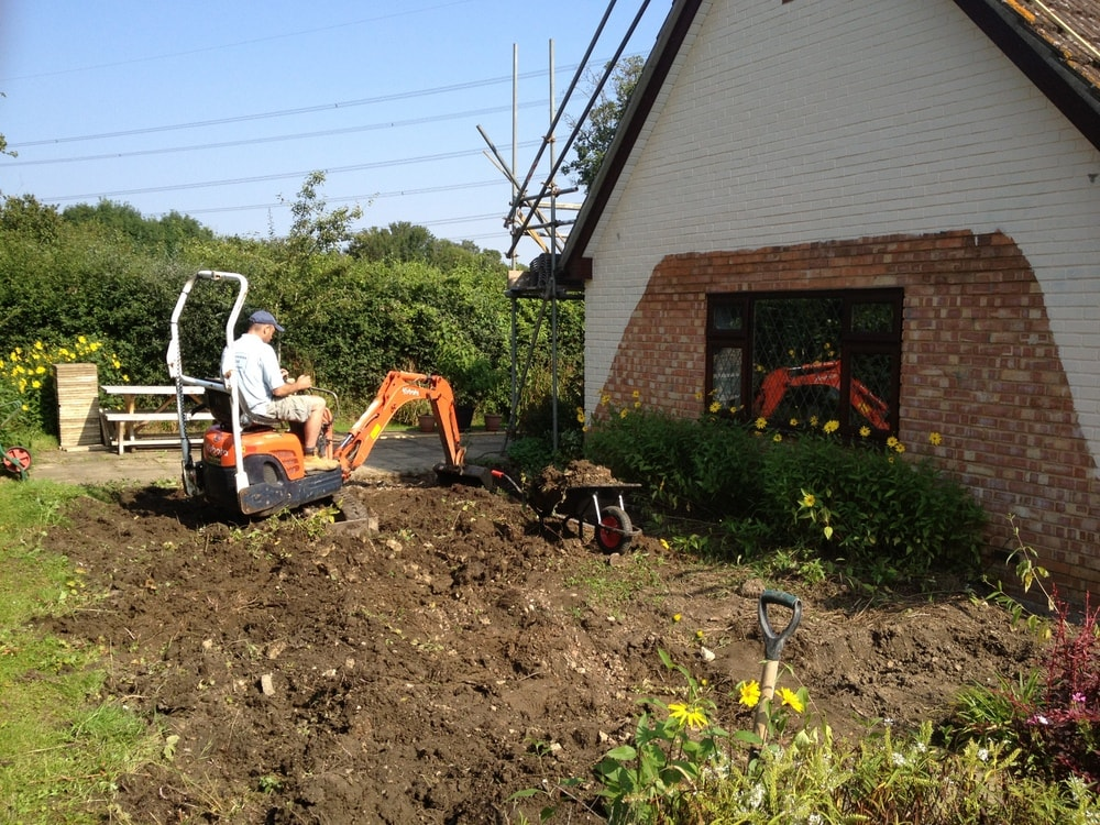digger groundwork to a conservatory