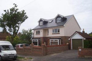 Detached house in Portsmouth loft conversion with 3 bedrooms and 5 dormer windows with pitched roof. Family bathroom and Velux MK08 window above staircase