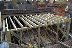 Construction of rear elevation flat roof dormer to a loft conversion