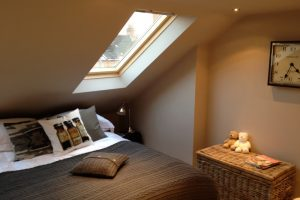 Front elevation to a loft conversion with Velux window installation.