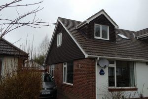 Bungalow with side elevation gable wall with tile hanging in Portsmouth. Front pitched roof dormer