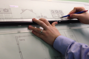 Architect drawing the stages of a loft conversion
