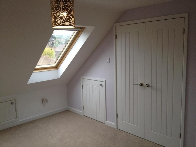 Cupboards to a loft conversion in Portsmouth. Velux window to front elevation.