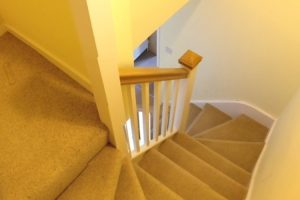 Staircase with oak handrail to loft conversion in Portsmouth