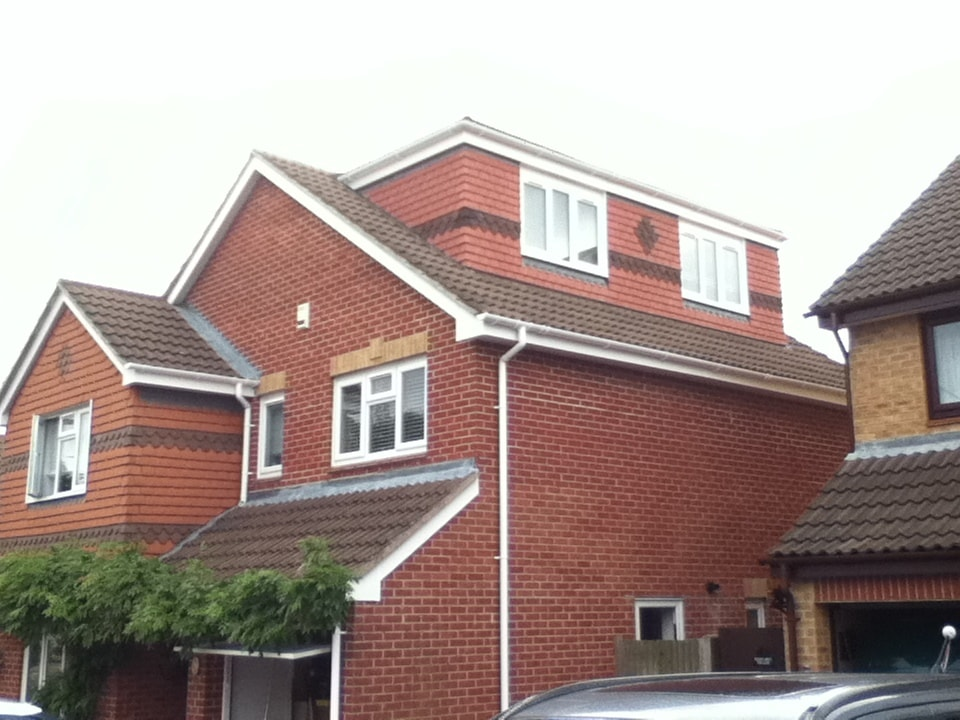Side dormer loft conversion. Flat roof dormer loft conversion