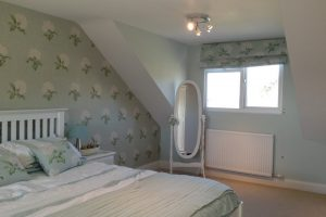Multiple bedrooms to detached house. Three bedrooms with shower suite. Dormers to rear elevation. New roof with slate.
