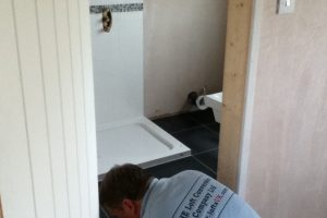 En-suite shower room tiling floor to a loft conversion in Portsmouth