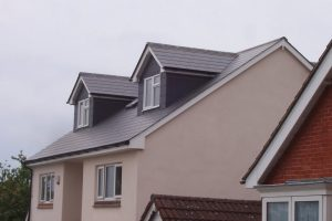 Slate dormers to loft conversion in Portsmouth. Detached house 3 bedrooms with shower room suite.