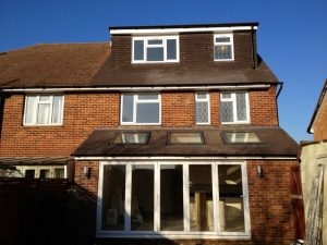 Finished loft conversion and rear extension. Rear dormer. Gable wall. Velux windows to extension. Bi-fold doors to extension. Location Drayton, Portsmouth