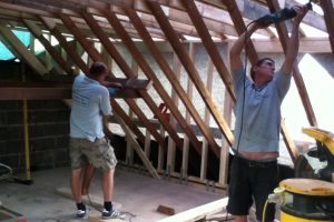 Cutting out rafters to a loft conversion in Portsmouth then continue building the rear elevation flat roof dormer