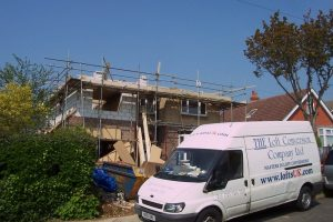 Front elevation of detached house. Loft conversion and extension being built