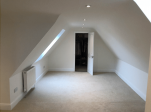 Walk in wardrobe to a loft conversion in Cousins Grove, Southsea