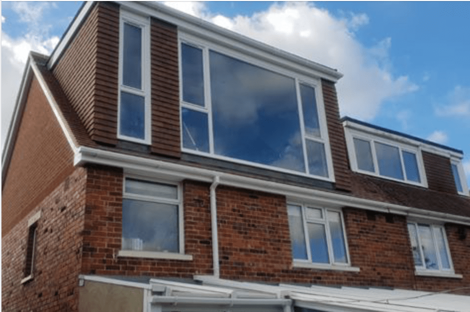 THE Loft Conversion Company (Portsmouth) Ltd. Rear elevation flat roof dormer