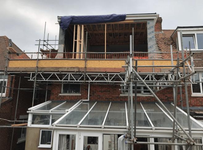 Rear elevation of loft conversion, flat roof dormer under construction.