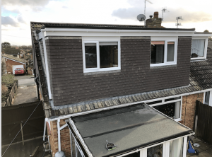 Rear elevation flat roof dormer to a bungalow loft conversion. In Portsmouth with tile hanging.