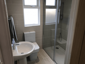 Shower suite built into a bungalow loft conversion in Portsmouth.