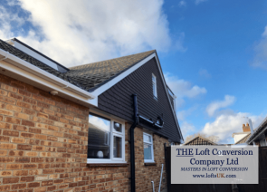 A bungalow with a loft conversion with timber built gable wall and tile hung with plain concrete tiles.