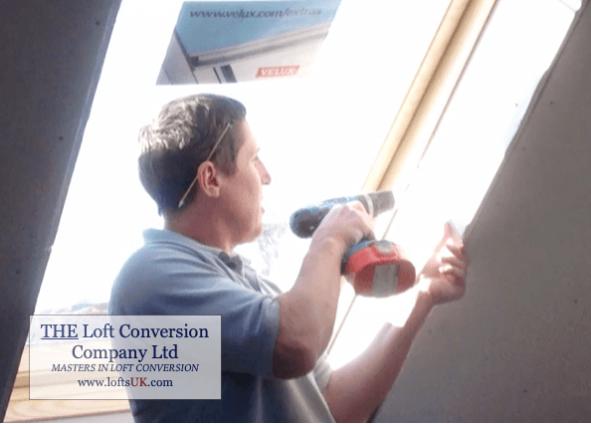 A loft conversion in Portsmouth carpenter fitting Velux window.