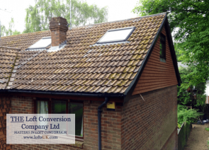 A loft conversion to a 3 bedroom house displaying the side elevation gable wall built in timber and tile hung with plain concrete tiles.