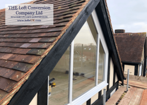 A loft conversion with a glass gable wall construction in the Portsmouth area.