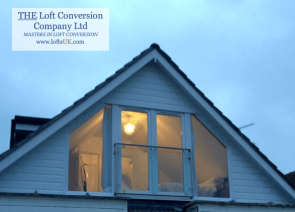 A loft conversion with a rear elevation glass gable wall with French doors and a stainless steel tubular Juliet balcony with 10mm glass panel for the modern look.