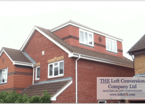Loft conversion in Portsmouth with a side elevation flat roof dormer.