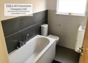 Completed bathroom in a loft conversion side elevation pitched roof dormer. Bungalow in Portsmouth area.