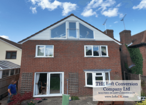 Rear elevation glass gable wall with French doors opening in. Juliet balcony with toughened safety glass. Loft conversion carried out to a very high standard in Portsmouth area.